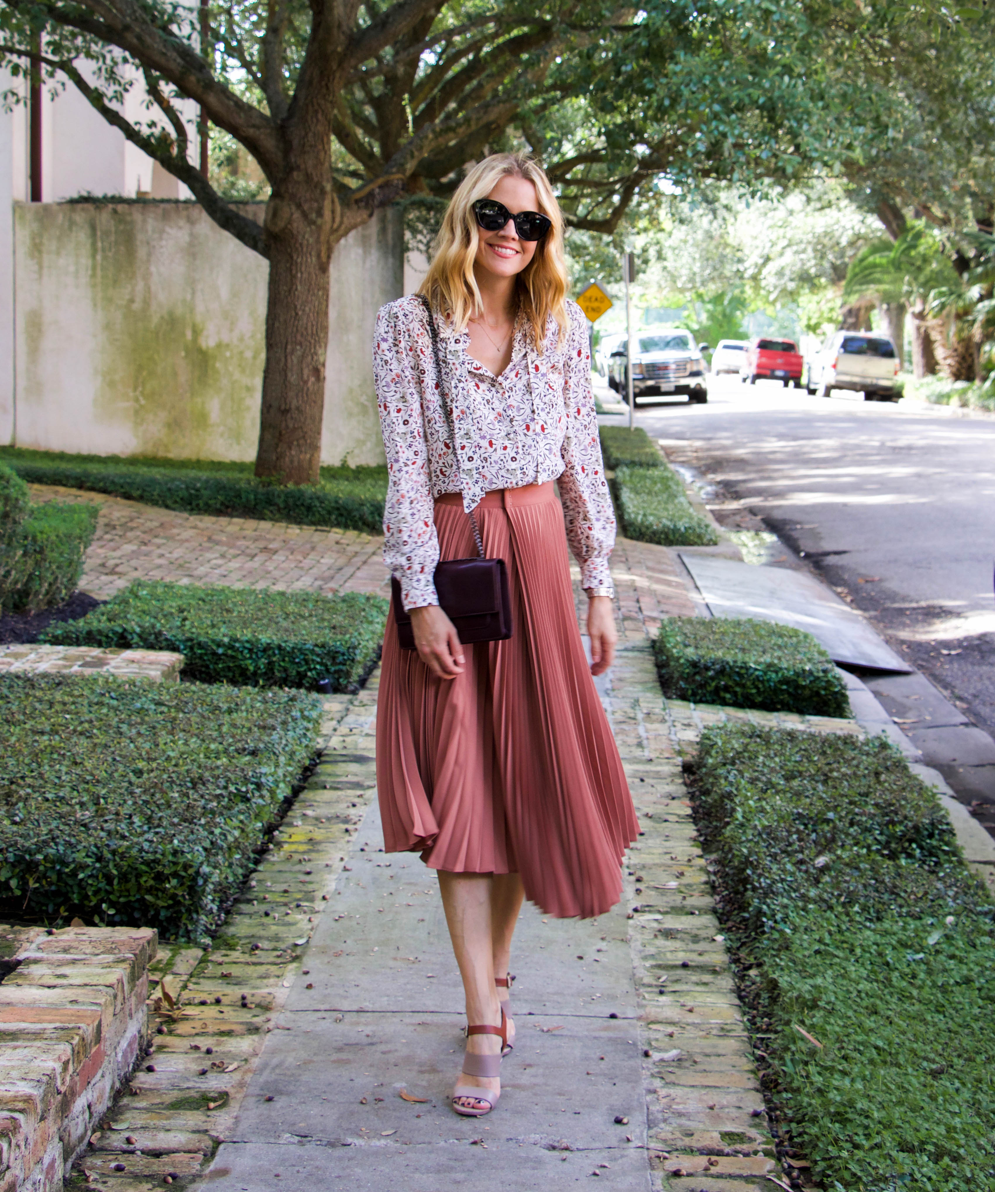 Vince pleated skirt + Frame floral blouse