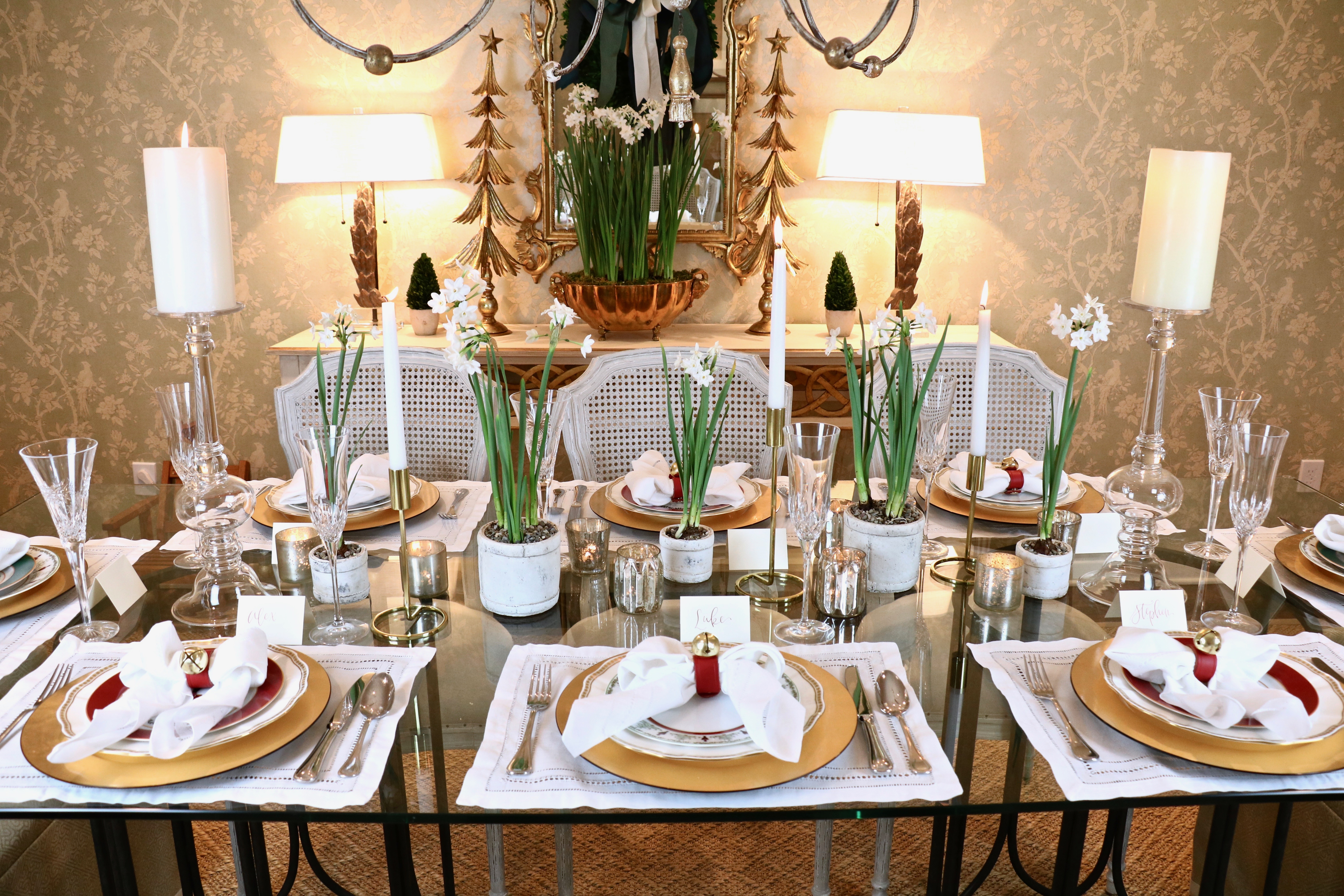 Fresh Christmas tablescape - paperwhites - votives - gold accents - bow napkins - festive - holiday - table setting - red and green